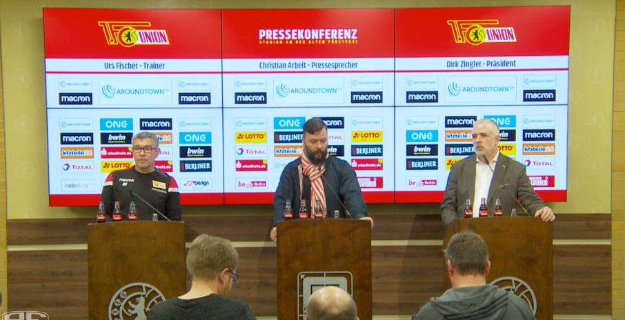 Pressekonferenz im Zeichen des Coronavirus: Trainer Urs Fischer, Pressesprecher Christian Arbeit und Präsident Dirk Zingler, Screenshot: AFTV